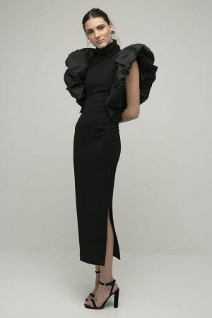 alquiler de vestido midi fiesta coco negro manga hombro abullonado apertura del diseñador Encinar 1